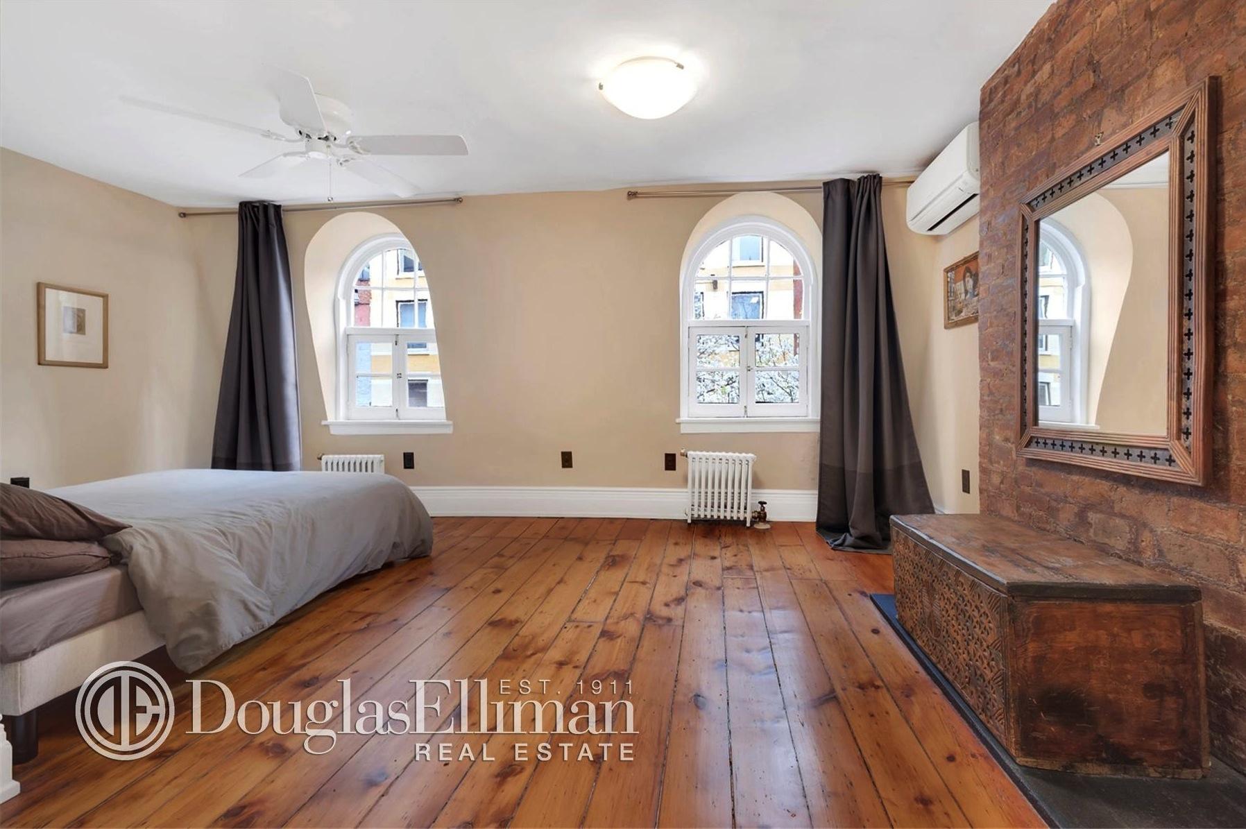 312 east 53rd street, master bedroom, wood framed house