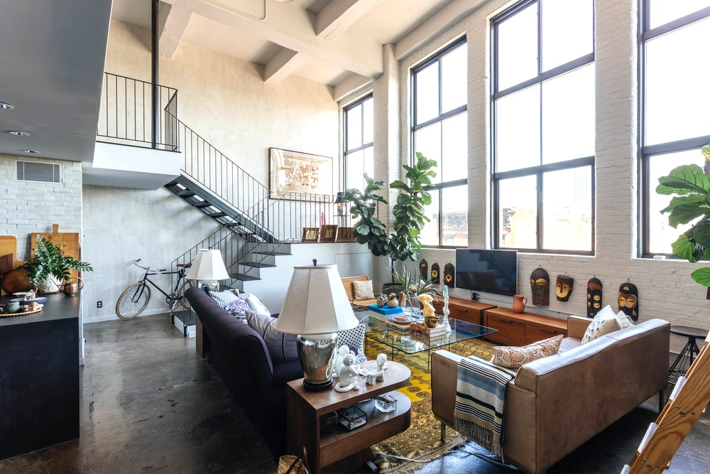 Brooklyn design firm creates dramatic living spaces inside for Living room west 6 brooklyn