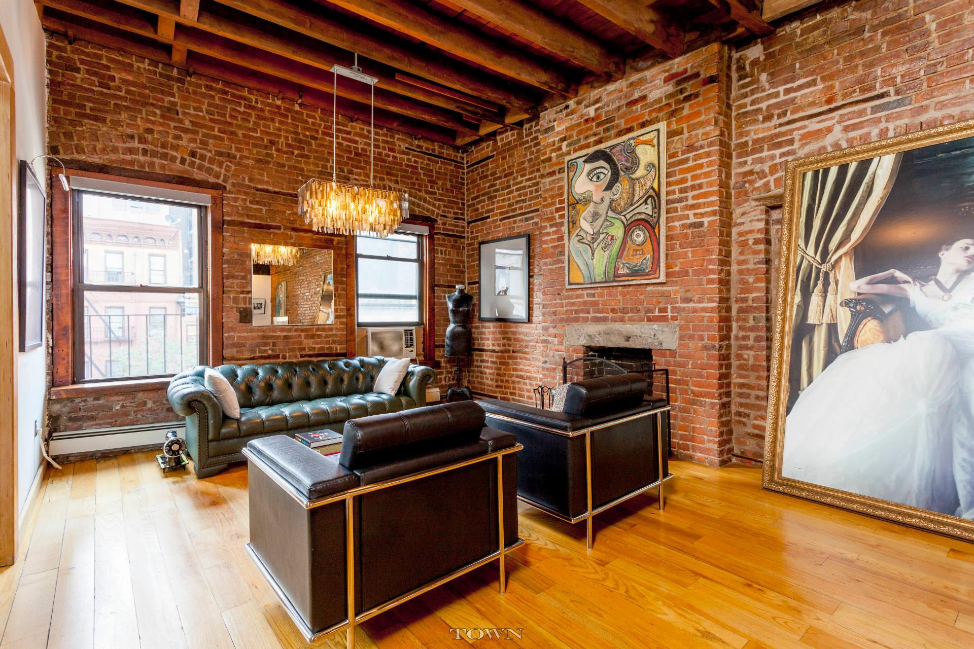 A 32-Foot Long Living Room With Exposed Brick Dominates