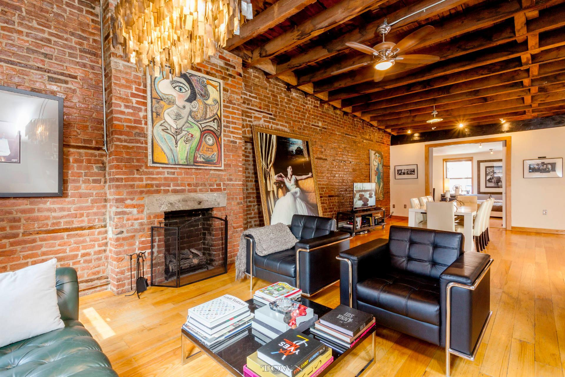 A 32 foot long living room with exposed brick dominates for 6 in the living room