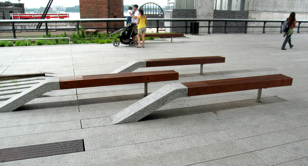 Benches grow out of the pavement at the Highline. Image © Flickr user Kris Arnold