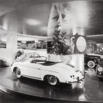 A black-and-white photo of the Frank Lloyd Wright auto showroom.