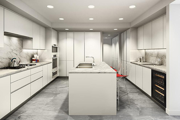 If the Upper East Side is more your thing, the elegant prewar building at 737 Park Avenue and 71st meets modernity, with its state of the art white eat in kitchen featuring Varenna cabinetry and Miele appliances. The marble-topped kitchen island has dual sinks by Franke, with an extra countertop sink that hovers near the built-in wine refrigerator. The matching marble floor ties the cool white kitchen together.