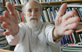 architect Frederic Schwartz with outstretched arms