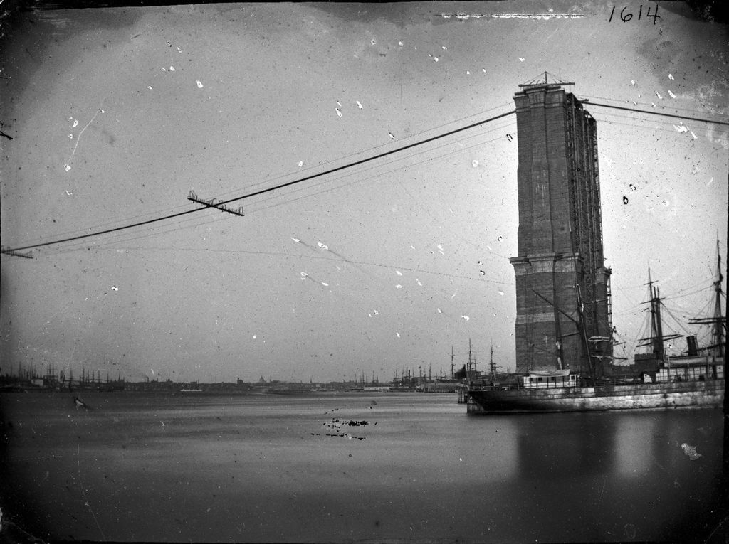 A 19th-century photo of the Brooklyn Bridge under construction.