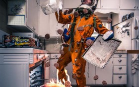 astronaut trying to cook
