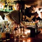 A bartender inside PDT.