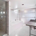 377 West 11th St 1A, Halstead Properties, loft interiors, glazed glass, translucent industrial sliding doors
