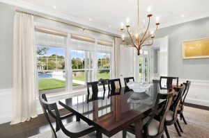 homes hamptons, famous homes for sale, tennis court hamptons, beach style furnishings, dark wood dining room table