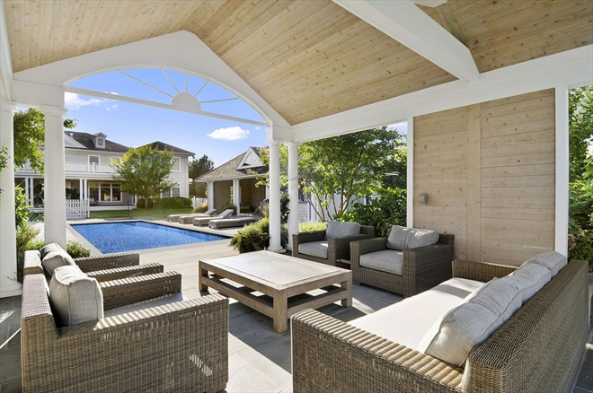 homes hamptons, famous homes for sale, tennis court hamptons, beach style furnishings, wrap around porch, outdoor furniture