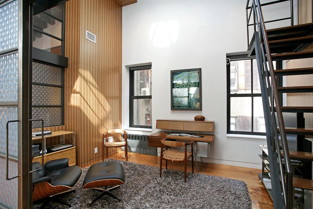 60 East 13th Street, loft conversion, apartment with skylights, hidden room behind bookcases, custom steel and glass sliding doors