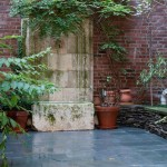 314 East 69th Street, Oliver Cope architect, bluestone tile garden with limestone fountain, refurbished antique English tub,