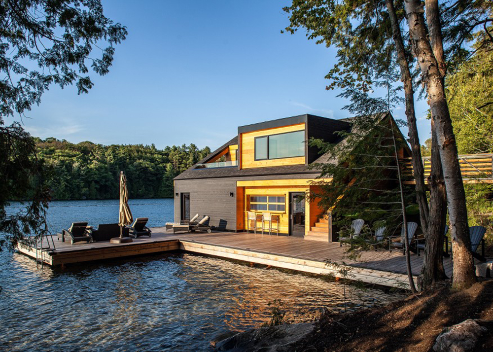 Altius architecture 39 s wooden boathouse puts a contemporary for Lakefront cottage plans canada