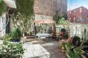 92 Horatio Street, garden with climbing ivy, handcrafted doors from Argentina