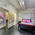 50 West 29th Street, dark-stained red maple floors, 70-feet of windows, no doors,