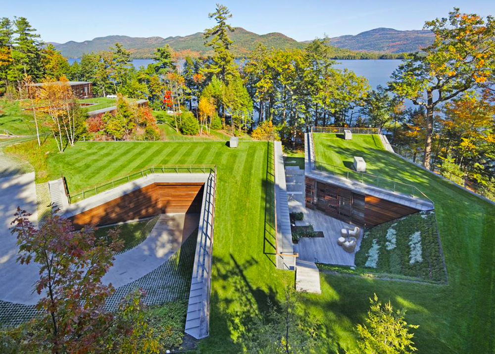 Gluck+'s Stunning Lake House is Partially Buried Under a Luscious