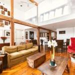 289 Bleecker Street, double-height ceilings, whitewashed exposed brick, refinished original wide plank hardwood floors