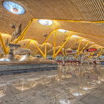 Very large angled bamboo struts were used by Richard Rogers and Antonio Lamela in supporting a very large canopy at the Barajas Airport Terminal 4 in Madrid Richard Rogers and Antonio Lamela created in 2006 a soothing, awesome, enveloping and comforting wavy orange canopy with angled bamboo struts at the Barajas Airport Terminal 4 in Madrid.