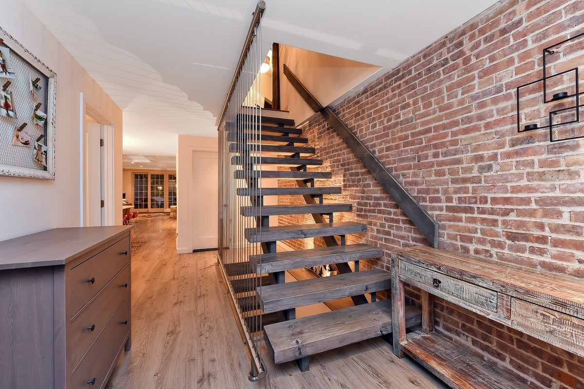 A modern reno inside this modest clinton hill townhouse for Open staircase