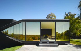 UNStudio, experimental home, VilLA NM, Moebius House, fluid interiors, reflective glass, white inside black outside, open plan interiors, burnt in a fire