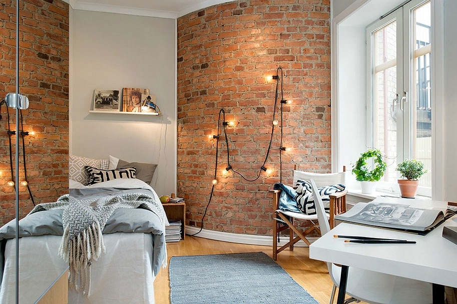 brick wall-string lights & 10 Ways to Decorate an Exposed Brick Wall Without Drilling | 6sqft