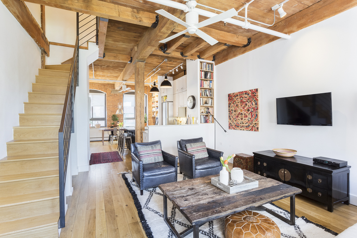 Ansonia loft with exposed wood beams and big brick framed for 420 room decor