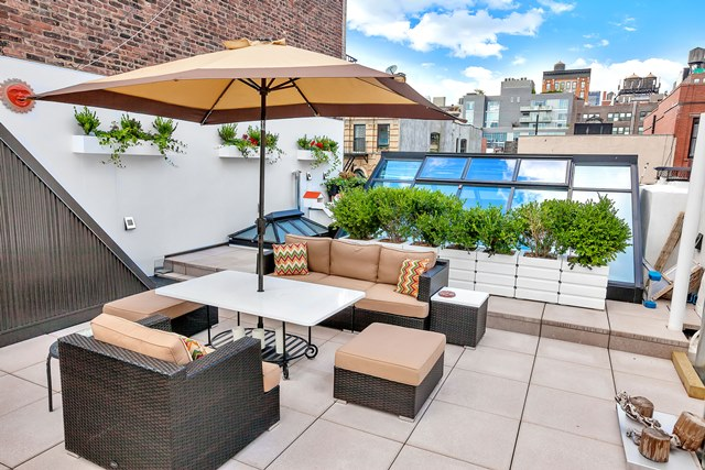 232 West 15th Street, cool listings, chelsea, swimming pool, pool, saltwater pool, pool house, waterfall, townhouse, quirky homes, manhattan townhouse for sale, interiors, pool in living room, evelyn mcmurray, evie mcmurray,