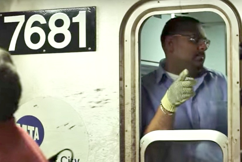 Conductor pointing at Zebra board New York Subway