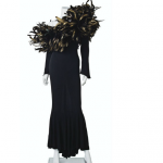 A BLACK JERSEY AND FEATHER-EMBELLISHED LONG-SLEEVED GOWN