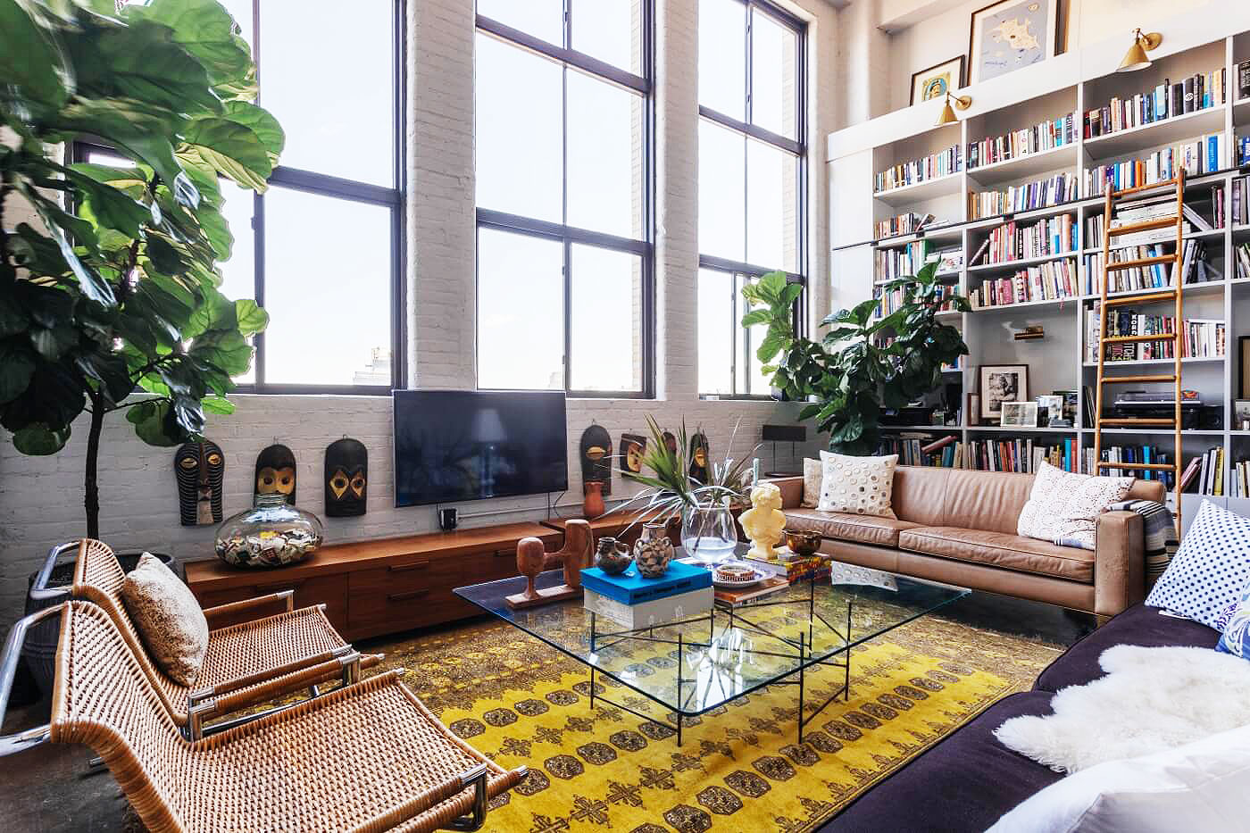 Brooklyn design firm creates dramatic living spaces inside for Living room brooklyn