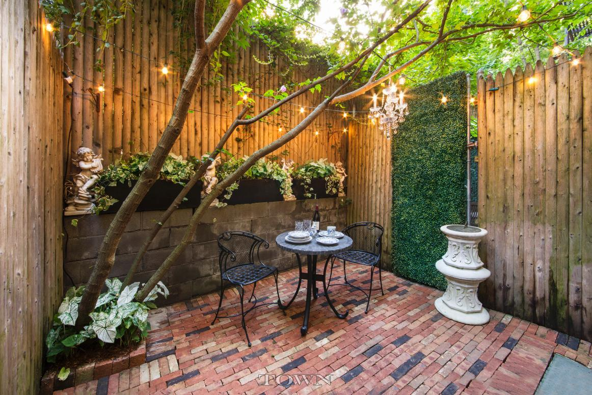 $1.4M Chelsea duplex has lots of charm and a magical garden, but a ...