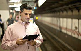 e-reader on subway, NYC subway