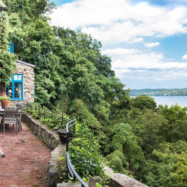 1920s stone house built on the cliffs of the Palisades is asking $4.6M