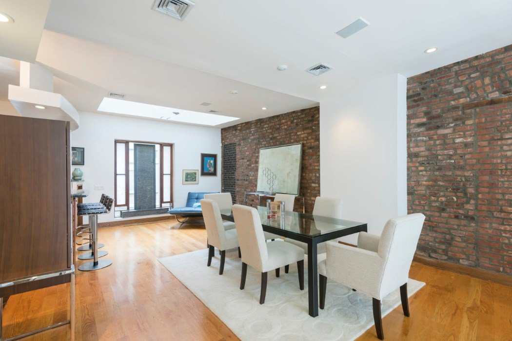 Five story chelsea townhouse with 22 foot ceilings renting for 10 foot living room