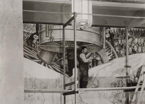 Rivera Diego working on mural in Rockefeller Center in 1933