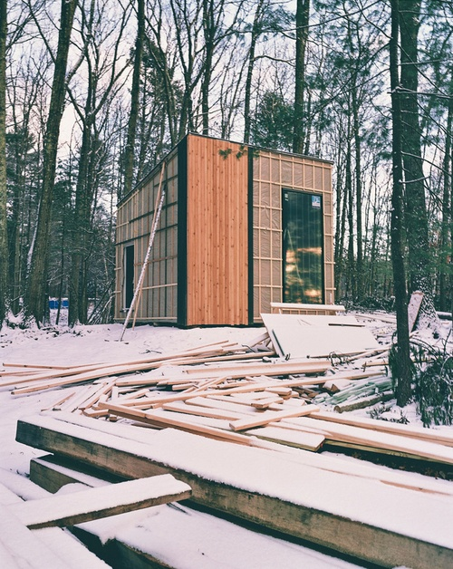 Studio Padron black cabin exterior during construction. Photo by Jason Koxvold