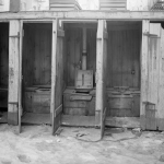 row of outhouses