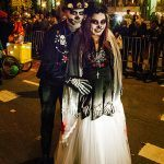 Dia de los Muertos Couple at Sixth Avenue near Spring Street. The crowds are finally allowed to roam freely and the northward march along Sixth Avenue begins.