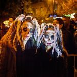"La Catrinas near Carmine Street. Light up hair extensions really stood out for us. The 2015 theme for the Parade was ""Shine A Light,"" based on Martin Luther King's quote, ""Darkness cannot drive out darkness: Only light can do that."" The 2016 theme for the 43rd Annual Village Halloween Parade is ""Reverie,"" inviting one and all to recreate their waking dreams.Each year the Parade and Dream Music Puppetry Program, led by veteran Parade Puppeteer Basil Twist and HERE Arts Center Co-Founder Barbara Busackino commission 3 artists or groups to design and construct Giant Pageant Sized Puppets built around the theme of the Parade."