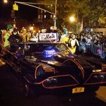 Batman and his Batmobile. North of Carmine Street we run into the Batmobile rolling northward. Only a limited number of motorized vehicles are allowed in the Village Halloween Parade and they all require prior arrangements with the Parade to get official permits. Motorized vehicles that just 'show-up' at the Parade will be kindly requested not to join the celebration and be turned away.