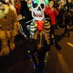 Skeleton. Near West 3rd Street. The relatively warm night and great weather make the march fun and the Village seems like the center of the world.