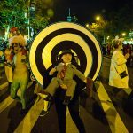 Spiral. Near West 4th Street. The inventiveness of the costumes we have seen makes the blocks fly by.