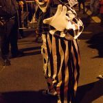"Clown. Near West 12th Street. According to the New York Times, ""the Halloween Parade is the best entertainment the people of this City ever give the people of this City."" The Parade marchers are funneled eastward down 16th Street signaling the end of the Parade. We shuffle along slowly between more police barricades."