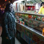 Grim Reaper.Union Square South. Parade marching is hungry business, even for Death itself. The Grim Reaper recharges his battery at one of the many food carts.
