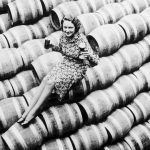 Woman sitting on barrels of beer after repeal day