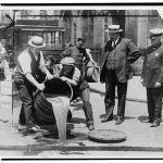 Alcohol getting poured into sewer in NYC, 1920