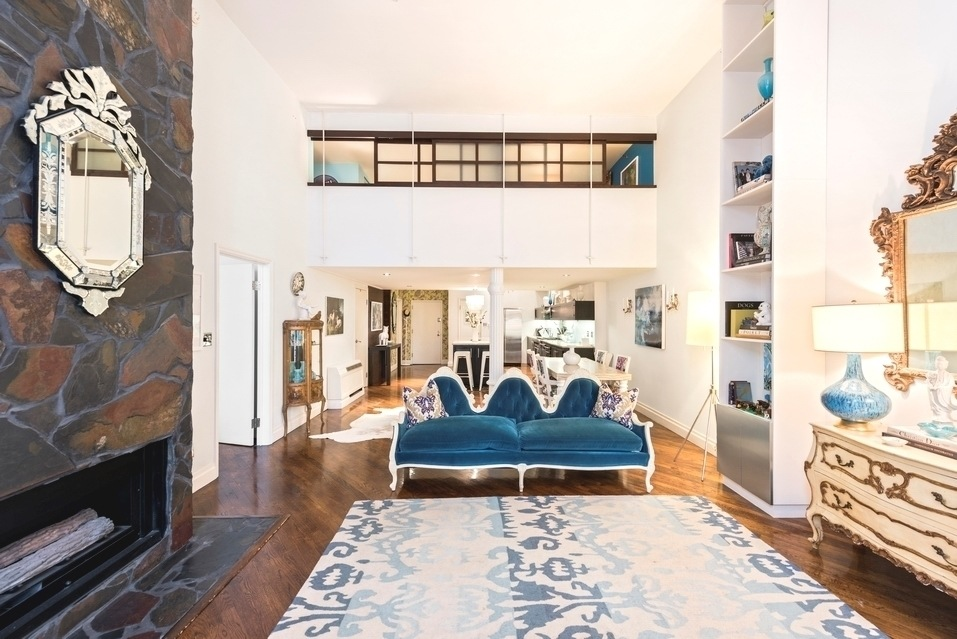 VIEW PHOTO IN GALLERY & A grand fireplace and double-height ceilings at this $2.4M Chelsea ...