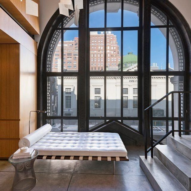 In the historic West Village Bank Building, a $3.45M condo boasts a 17-foot window