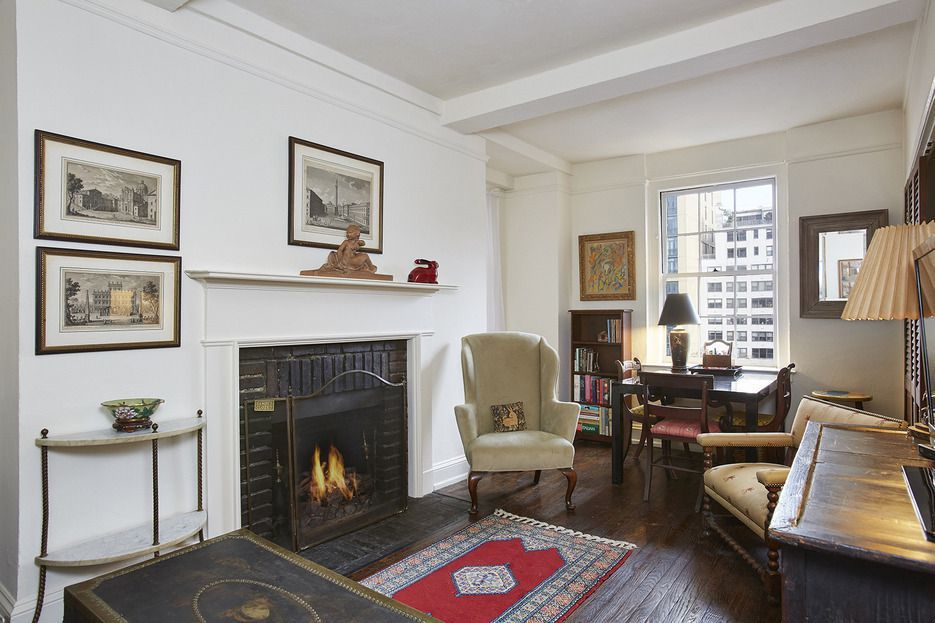Curl up by the fire in this cozy East Side one-bedroom for only $495K
