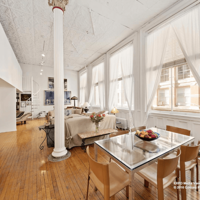A photographer's classic Soho loft complete with furniture and art asks $10K/month